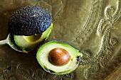 A halved avocado with stone