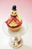 A cupcake decorated with a snowman for Christmas