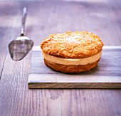 Bienenstich (caramelised almond cake) with icing sugar