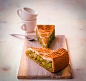 Two slices of rhubarb cake with hazelnut meringue