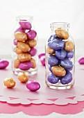 Foil wrapped mini chocolate eggs in mini milk bottles
