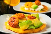 Arepas with avocado, cheese, plantains and lettuce