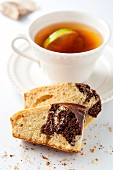 Marble cake and black tea with lemon