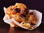A cranberry muffin with a bite taken out (close-up)