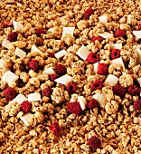 Crunchy muesli with raspberries and pieces of white chocolate