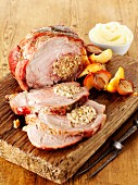 Roast pork with apple stuffing and mashed potatoes