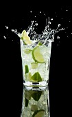 A splashing Caipirinha against a black background