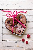 A heart-shaped chocolate and raspberry cake
