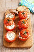 Grilled tomatoes filled with goat's cheese and rosemary
