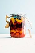 A jar of rum fruits