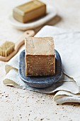 Olive soap in a stone dish