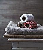Three spools of kitchen twine on linen cloth