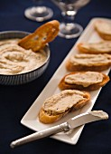 Crostini topped with a bean and rosemary spread