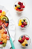 Fruit salad with strawberries, pineapple, kiwi, oranges and raspberries