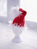 A Father Christmas hat as an egg cosy