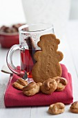 Mulled wine, gingerbread and Christmas biscuits with cashew nuts on a red cloth