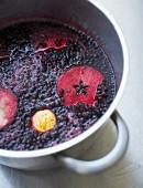 Stewed elderberries in a pot