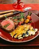 Truffled potato gratin, stuffed beef tenderloin wrapped in bacon and roasted red and yellow beets
