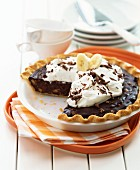 Chocolate and banana pie with cream, sliced