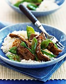 Beef and mange tout stir fry on a bed of rice