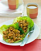 Chicken salad served in lettuce leaves with tea (China)