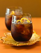 Cola with rum and orange zest