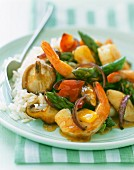 Prawn and vegetable stir fry with a side of rice