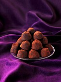 Dark chocolate truffles on a plate