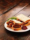 A sausage sandwich with salsa
