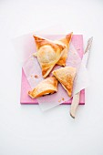 Puff pastry triangles with a chocolate and peach filling