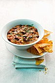 Rice stew with chilli beans and tortilla crisps