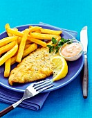 Breaded sole fillet with fries and sauce