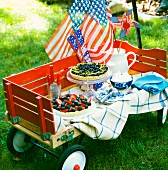 A cake buffet with a flag waving in the wind