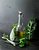 An arrangement of olive oil, vegetables and herbs