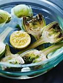 Raw artichokes in lemon water