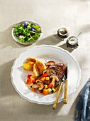 Venison escalope on a bed of colourful vegetables