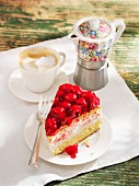 A slice of yogurt cake with raspberries served with coffee