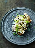 Fried porcini mushrooms with spring onions on grilled bread