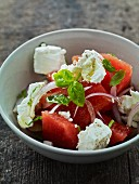 Water melon salad with onions and feta