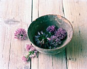 A bowl of chive flowers