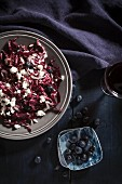 A winter salad with red cabbage, blueberries and ricotta