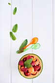 Melon with strawberries and fresh mint