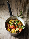 Ratatouille with rocket in a saucepan
