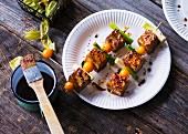 Tofu skewers with physalis