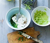 A yogurt dip with grated cucumber and lime being made