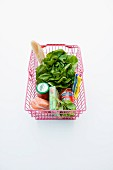 Salmon fillet, tinned tomatoes and lettuce in a shopping basket