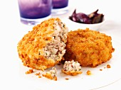 Breaded sausage meat patties with onions