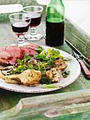 Roast lamb with lamb's lettuce and artichokes