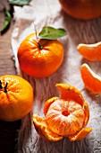 Mandarin oranges, one peeled