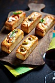 Spicy cakes with olives and smoked salmon